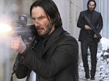 An Act of Vengeance? Keanu Reeves uses cars for cover as he films John Wick while toting a machine gun on streets of New York