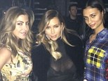 Oh la la: Kim shows off her buxom chest in a sheer dress whilst at Kayne's Yeezus Tour gig in Chicago on Wednesday