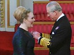 Delicate operation: Prince Charles tried to keep a steady hand as he pins the honour on Adele's stunning Stella McCartney dress