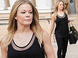 Need some holiday cheer? LeAnn Rimes opts for basic black tank top and leggings on solo shopping trip