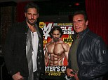 Muscle men: Joe Manganiello and former bodybuilder and actor Arnold Schwarzenegger pose for a photo in front of Joe's ripped front cover