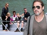 He's still a heartthrob! Brad Pitt lets 50th birthday pass unmarked... but 'will celebrate with Angelina and the brood this weekend'