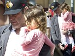 Daddy's little birthday girl! Vince Vaughn carries his tired little ballerina after a big day at Disneyland