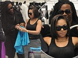 See something you like? Ashanti insists she is 'definitely single'... but grins as mystery man helps her into a jacket on shopping trip