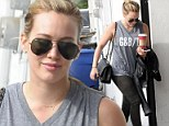Energy to burn! Hilary Duff continues her workout routine with caffeine in hand to beat the resolution gym rush