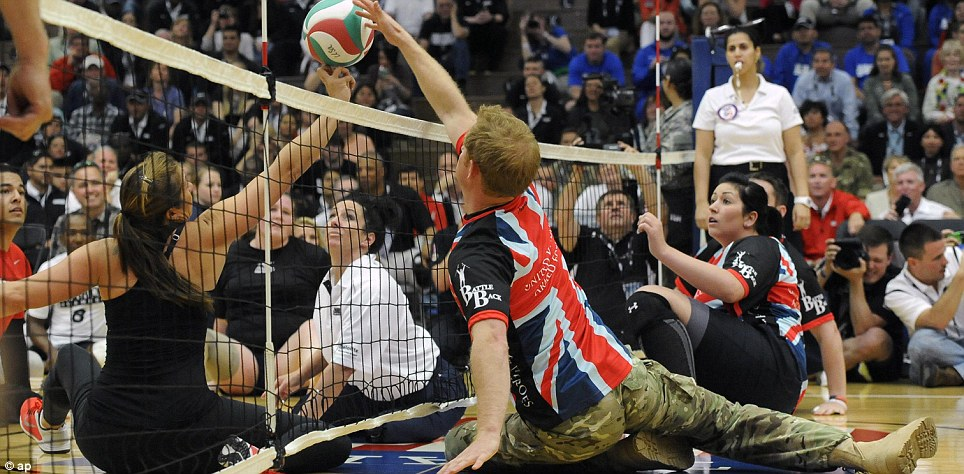 Point scoring: Prince Harry was relaxed among fellow armed forces veterans and seemed more himself on the court