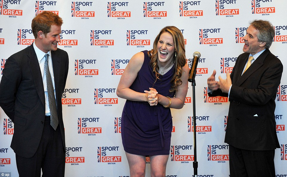 Birthday girl: Britain's Prince Harry, left, and British Ambassador Peter Westmacott, right, celebrate the 18th birthday of Gold medal swimmer Missy Franklin, center