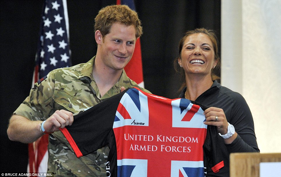 New pal: Prince Harry played sitting volleyball with Misty May Treanor, pictured. The pair play argued for the crowd when the royal managed to score a point against the athlete
