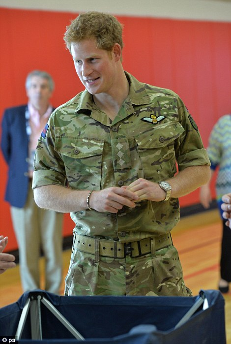 Prince Harry attends the warrior games and meets injured servicemen and their families in Colorado Springs.