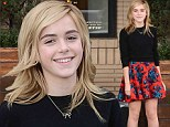 Kiernan Shipka looks lovely in a red floral circle skirt while Christmas shopping at Barney's New York