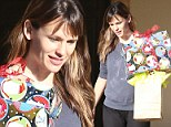 Making her presents known! Christmas comes early for make-up free Jennifer Garner as she leaves home bearing gifts