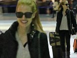 I've got this! Independent woman Jessica Chastain insists on lugging her own bags through the airport