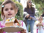 Alessandra Ambrosio's daughter Anja carries home her gingerbread house