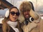 Just chillin': Mariah and Nick get cozy at their mountain retreat