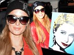 Another masterpiece for her mansion? Paris Hilton proudly poses with her latest self portrait at LAX