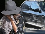 Embarrassed by your driving skills? Selena Gomez tries to go incognito after scraping her car on a pole