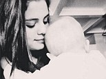 Sisterly love: Selena Gomez posted a photo of her holding a baby, presumably her six-month-old half sister, to her Instagram on Sunday, saying it's the happiest she's been in a long time