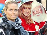 Santa's little helper: Heidi Klum posted a photo of her beaming next to Santa Clause to her Instagram on Sunday, with the caption - 'Love you Santa'