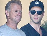 Two peas in a pod: Liam Hemsworth and his father Craig made a pit stop on Sunday for some iced drinks in Malibu, California