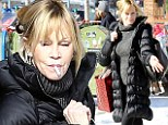 Melanie Griffith puffs on a cigarette as she fits in some last minute Christmas shopping in Aspen