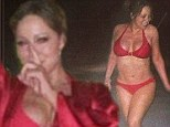 All I Want For Christmas Is... that bikini body! Mariah Carey shows off her amazing curves in a festive red two-piece while walking her dog in the snow