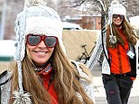 Elle Macpherson hides her famous body in ski chic while out in Aspen days after stepping out in quirky outfit