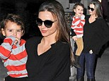 Doting mother: Miranda Kerr was seen out and about in New York City on Saturday, holding her two-year-old son, Flynn, close