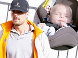 Precious cargo! Josh Duhamel is a hands on father as he carefully loads his sleeping infant into car