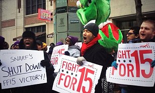 Rally: The firings come less than a month after Snarf's workers rallied, pictured, for higher wages with the Workers Organizing Committee of Chicago