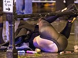 A Manchester Woman takes a tumble while out on 'Mad Friday' one of the busiest nights of the year