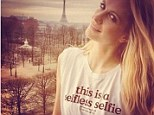 Strike a pose: Poppy Delevingne takes a 'selfless selfie' in a charity T-shirt to raise funds for the Philippines Typhoon Relief