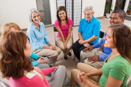 Diverse support group listening to friend tell story during disc