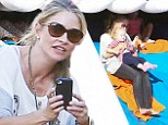 Weeee! Rebecca Gayheart took her daughter on a ride on the skull slide at Mr. Bones Pumpkin Patch in West Hollywood, California on Monday