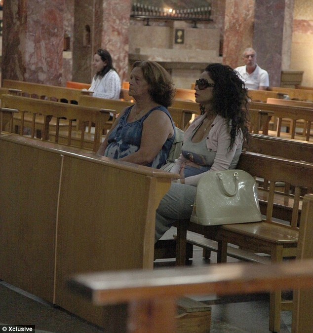 Looking for strength: Raffaella Fico was pictured attending a mass service as she visited the shrine of Padre Pio in San Giovanni with her family