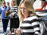 Not just for the girls! Hilary Duff glammed it up for a lunch date with her husband Mike Comrie and son Luca in Beverly Hills, California on Tuesday