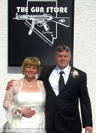 Happiest day of their lives: A couple pose underneath a sign for the Gun Store, where newlyweds exchange rings from the top of a shotgun shell (right)