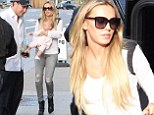 Chic: Petra Stunt works a neutral hued top and skinny jeans on outing with baby Lavinia