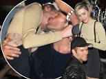 Seriously? Miley Cyrus makes her romance with Kellan Lutz official during Britney concert after party¿ but still grinds on two other guys