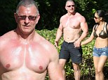 Chef Robert Irvine, 49, displays ripped chest on romantic stroll with his wrestler wife in Hawaii