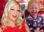 'So grateful for my family!' Tori Spelling shares cute Christmas morning video of her children unwrapping presents... as reports of marital strife continue
