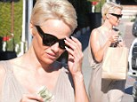 A long way from Baywatch! Make-up free Pamela Anderson covers up (a bit) on trip to a Malibu bakery
