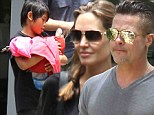 A new furry friend! Angelina Jolie and Brad Pitt dote on a baby kangaroo as son Pax, 10, carries the joey like an infant in a blanket