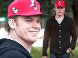 Too sweet to be a serial killer! Michael C. Hall takes his pup on a Christmas Eve stroll