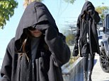 All black everything: Kylie Jenner steps out looking like the Grim Reaper in huge black hooded coat