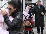 Hilaria Baldwin gives her baby girl a tender kiss as she steps out with husband Alec for a post Christmas pick-me-up