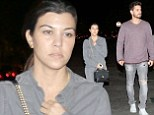 Kourtney Kardashian is uncharacteristically dressed down as she sports a grey jumpsuit for sushi date with Scott Disick