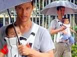 Baby on board! Doting dad Matthew McConaughey enjoys a stroll in Brazil with his youngest son Livingston