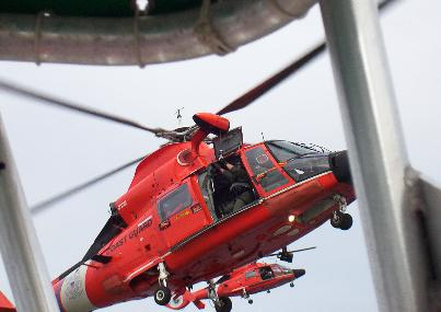 two USCG helos in air as seen from boat
