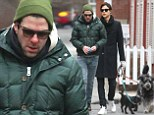 Puppy love! Zachary Quinto and rumored boyfriend Miles McMillan take his pet dogs for a Manhattan stroll