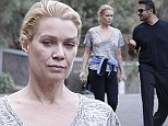 She's alive! Walking Dead's Laurie Holden takes a hike alongside a mystery man